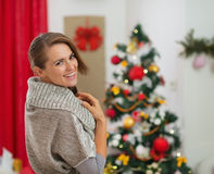 Portrait of happy young woman near Christmas tree Royalty Free Stock Photo