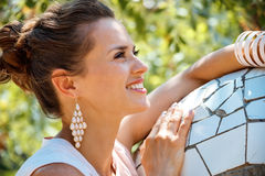 Portrait of happy young woman in Park Guell, Spain Stock Image