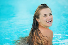 Portrait of happy young woman in pool Stock Image