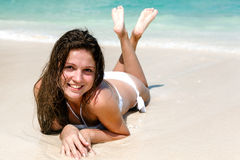 Portrait of a happy young woman posing while on the beach Royalty Free Stock Photography