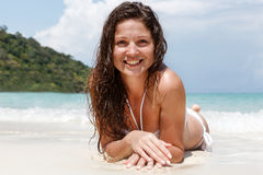 Portrait of a happy young woman posing while on the beach. Portrait of a happy beautiful young woman posing while on the beach Stock Image