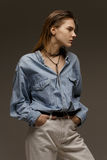 Portrait of happy young woman, posing in jean shirt Stock Photos