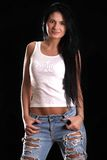 Portrait of a happy young woman in a ragged jeans and white slee Royalty Free Stock Image