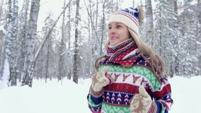Portrait of happy young woman running in the forest in winter stock video