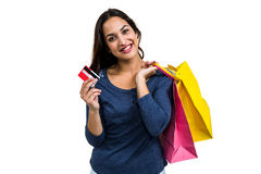 Portrait of happy young woman with shopping bags and payment card Stock Photo
