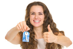 Portrait of happy young woman showing house key Stock Image