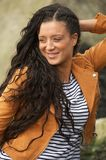 Portrait of a happy young woman smiling outdoors Royalty Free Stock Photography