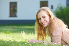 Portrait of a happy young woman smiling outdoors Stock Image