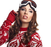 Portrait of a happy young woman snowboarding Royalty Free Stock Photography