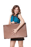 Portrait of happy young woman with suitcase Stock Photography