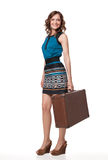 Portrait of happy young woman with suitcase Royalty Free Stock Photography