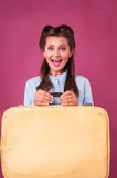 Portrait happy young woman with suitcase. Travel. Royalty Free Stock Images