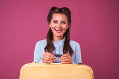 Portrait happy young woman with suitcase. Travel. Stock Photos