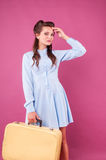 Portrait happy young woman with suitcase. Travel Royalty Free Stock Images