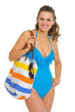 Portrait of happy young woman in swimsuit and beach bag Stock Photo