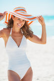 Portrait of happy young woman in swimsuit with beach hat Royalty Free Stock Photography