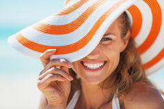 Portrait of happy young woman in swimsuit and beach hat Stock Image
