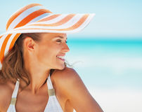 Portrait of happy young woman in swimsuit and beach hat Royalty Free Stock Photography