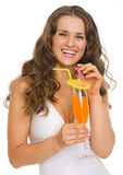 Portrait of happy woman in swimsuit with cocktail Stock Photography