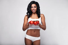 Portrait of happy young woman with tomato Royalty Free Stock Images