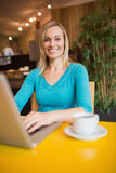 Portrait of happy young woman using laptop Royalty Free Stock Images