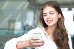 Portrait of happy young woman using mobile phone Royalty Free Stock Photo