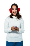 Portrait of happy young woman using mobile phone. Standing against white background Stock Image