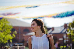 Portrait of happy young woman on a walk. Summer in the city Royalty Free Stock Photos