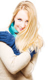 Portrait of a happy young woman in a warm gloves Stock Image