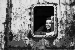 Portrait of happy young woman in the window vintage train. Stock Photo
