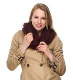 Portrait of a happy young woman with winter coat and scarf Stock Image
