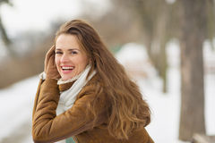 Portrait of happy young woman in winter outdoors Stock Photos