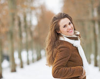Portrait of happy young woman in winter park Stock Image