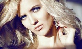 Portrait of hard light. Blonde volume hair. Royalty Free Stock Photography