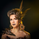 Portrait of harpy. Girl harpy. Creative make-up for Halloween Stock Photography