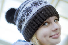 Portrait in a hat. Close-up of young girl in winter hat Royalty Free Stock Images