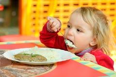 Portrait of having breakfast kid. Stock Image
