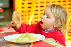 Portrait of having breakfast kid. Royalty Free Stock Image