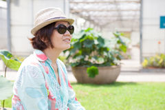 Portrait head shot face of asian woman with sun glasses and stra Stock Photo