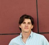 Portrait head shot of a handsome twentysome man stock images