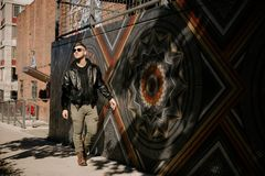Portrait Headshots of a Young Handsome Attractive Modern Fashion Caucasian Male Guy Modeling near Local Outdoor Art in Urban City stock photos