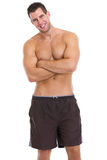 Portrait of healthy muscular guy in shorts Royalty Free Stock Photos
