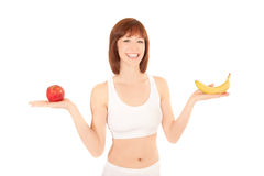 Portrait of healthy woman with apple and banana Royalty Free Stock Image