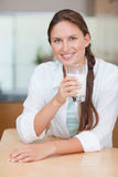 Portrait of a healthy woman drinking milk Stock Image