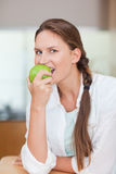 Portrait of a healthy woman eating an apple Stock Photos