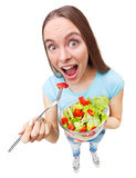 Portrait of a healthy woman eating a fresh salad. Stock Images