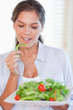 Portrait of a healthy woman eating a salad Stock Image