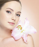 Portrait of healthy woman with flower Royalty Free Stock Photos