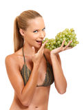 Portrait of a healthy woman with grape Royalty Free Stock Images