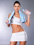 Portrait of a healthy woman with water and towel. Royalty Free Stock Photos